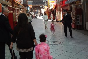 Two pretty girls in kimono; one coming and one leaving!