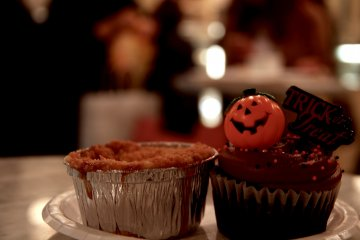 A delicious and traditional apple pie (left) and a Halloween themed chocolate cupcake (right)