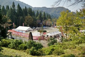 The main festival area surrounded by mountains
