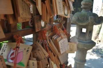 <p>People wrote their prayers on these plaques and hung them up in the shrine</p>