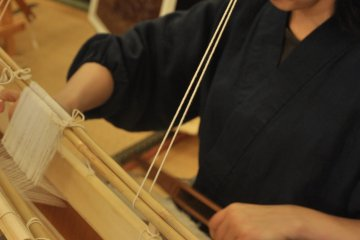 <p>The yarn is then woven to into cloth</p>