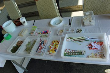<p>The assortment of maple leaves, grasses and flowers, and decorative paper provided for the washi making</p>