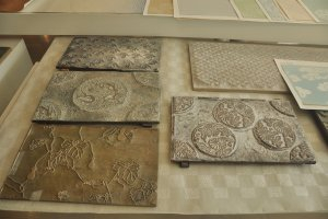 Woodblock printing is used to create pictures or patterns on the paper