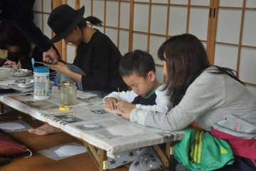 <p>People can try the various steps of making a Buddhist altar</p>