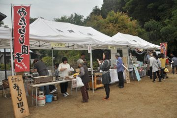 <p>In an emptied car park, a food court is set up for people to rest and eat</p>