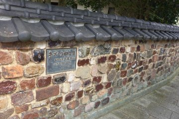 <p>This wall was made from pieces of old kilns</p>