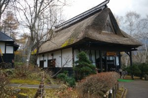 A traditional house next to the entrance doubles as a folk museum