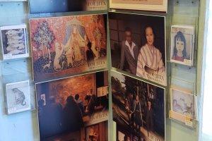 역시 깊은 화구상 분포도의 입구를 장식하고 있는 후지타 쓰구하루 전기 영화의 포스터.