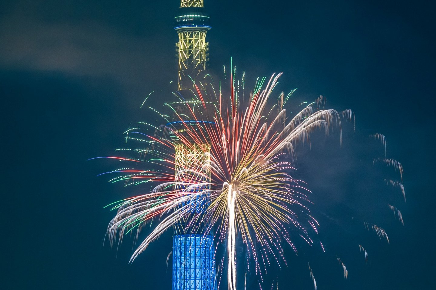 Colorful fireworks in front of the Tokyo Skytree
