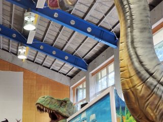 Dinosaurs tower over the exhibits.