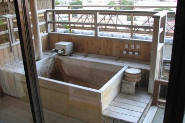 <p>Our private soaking tub as it was being filled.</p>