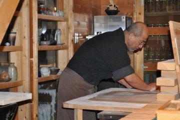 Rai-san preparing a fresh serving of noodles
