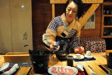 Midori-san lighting up the shabu-shabu pot