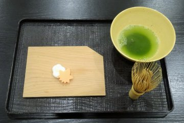 <p>Visitors have a chance to mix their own bowl of matcha and enjoy it with a sweet</p>