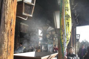 Incense fills the hall for the New Year's holidays