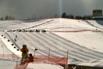 Tube-sledding at Takino Snow World