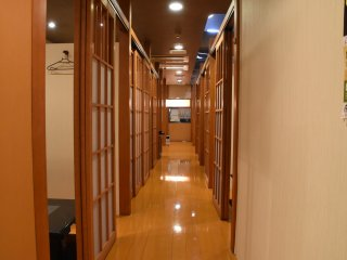 Private rooms are placed on both sides of the corridor