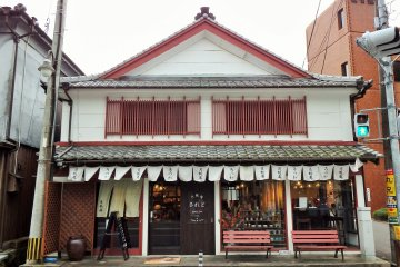<p>The cafe/gallery is only one of many traditional Japanese buildings on this street.</p>