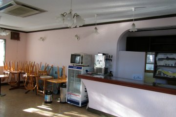 <p>The interior of the cafe. It looks like people left just yesterday</p>