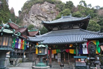 <p>The Hon-do (Main Hall) and the seated Buddha in the cave on the cliff above it</p>
