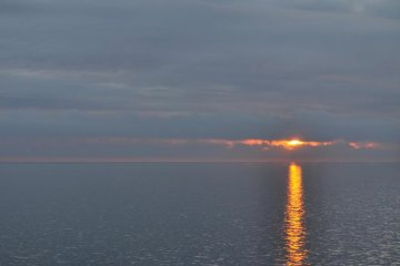 The sun sets as the ferry approaches Hokkaido