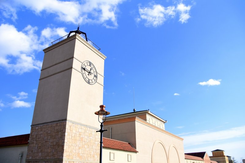 <p>Entrance building of Nasu Garden Outlet making a stark contrast against clear blue sky</p>