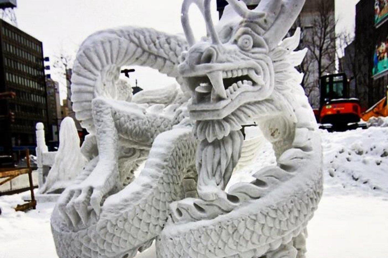 Победитель Всемирного Снежного Конкурса Скульптур: Дракон из Гонг Конга