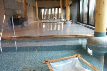 <p>Taking a dip in the Natorinomiyu bath, famous for being the same bath feudal lord Date Masamune bathed in 400 years ago</p>