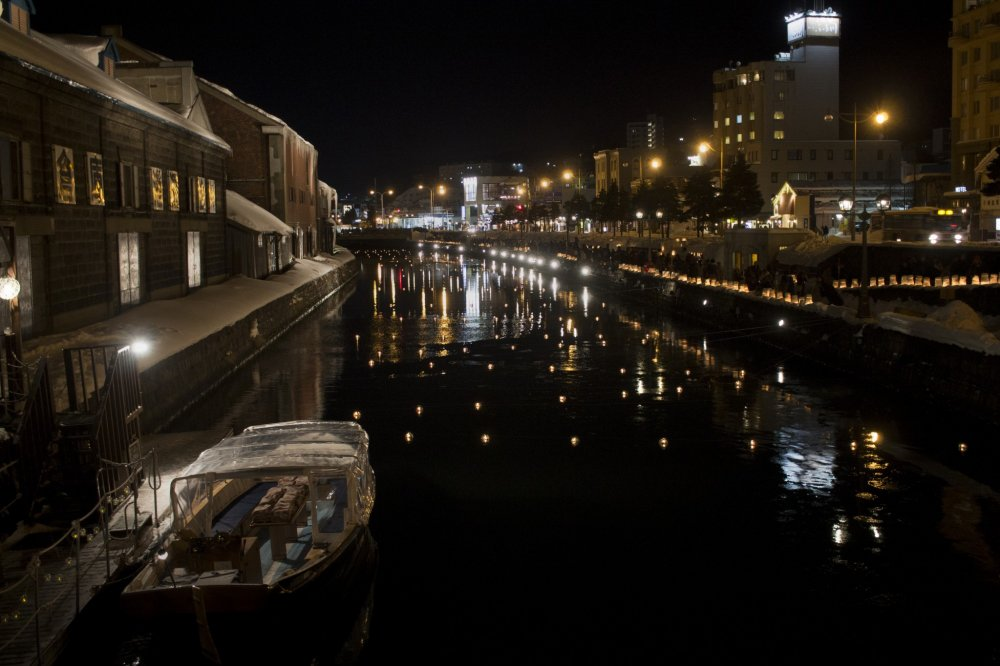 Lights flicker and dance along the canal
