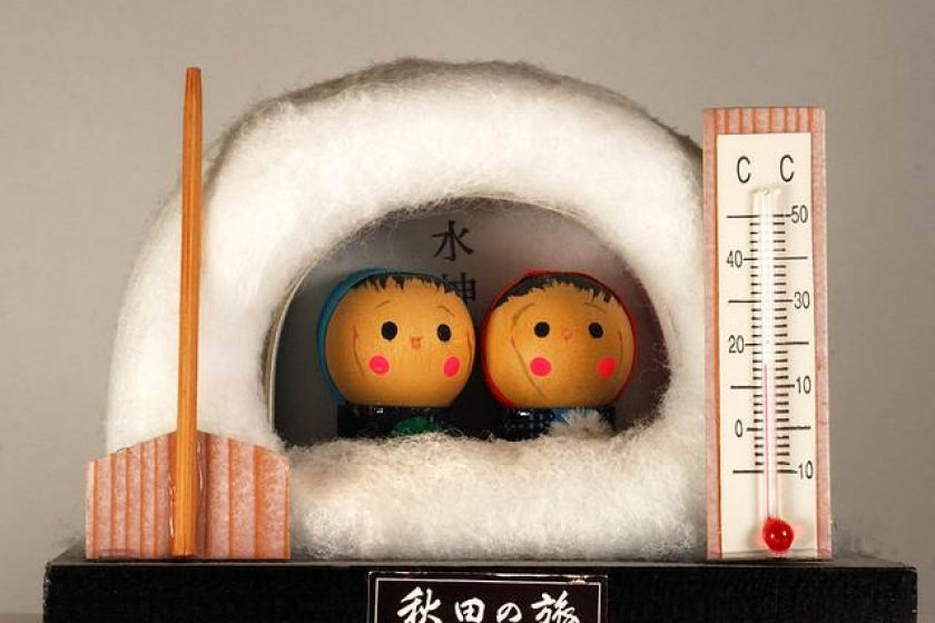 traditional dolls in a snow hut
