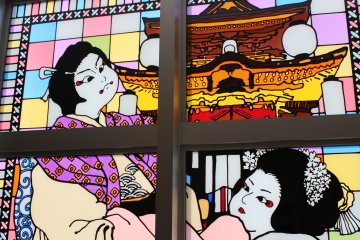 A stained glass window depicting a scene from kabuki