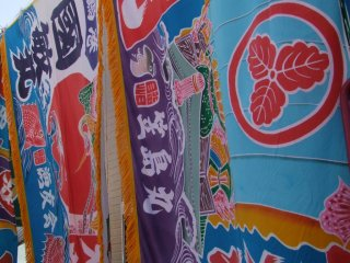 A town event, sparkling with the colorful flags of local fishing boats