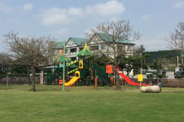 Children's playground in the middle of the lawn.