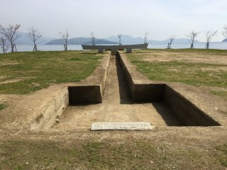 #84 Garden of the Border by Mitsuharu Doi is a sunken Torii gate, like something recently excavated and quite the opposite of the floating Torii gate at Miyajima near Hiroshima