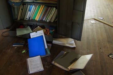 Papers and folders, all left behind.