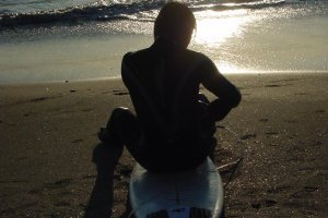 Surfer enjoying the sunset at Yuigahama Beach