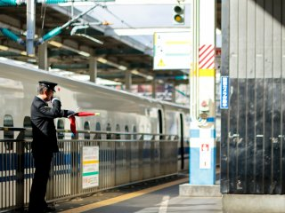 Officer giving signals for the train