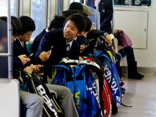 Middle school students going to their extra curricular activities via train