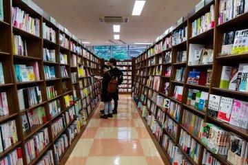 A couple browsing through Japanese books