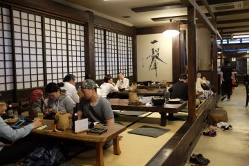 Seating is at traditional tatami-style booth and several wooden tables and chairs