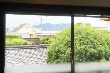The guesthouse has a view of the distant mountains
