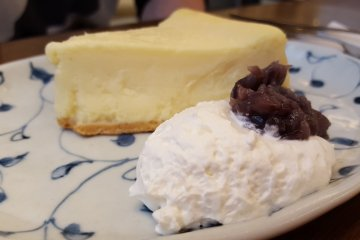 Cheese cake with red beans and whipped cream