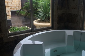 The suite room (16,000 yen from 10pm - 11am), with this gorgeous indoor bath with a giant flat screen tv. Want to experience the patio? There is also a bath on the patio, to the left of the window (Fukushima Prefecture)