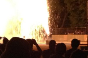 Hand held Tezutsu fireworks dwarf the participant.