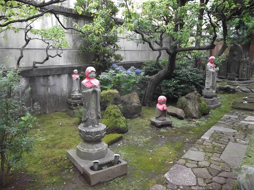 Statues in their little garden