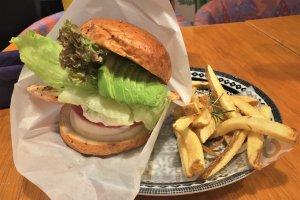 Salmon, avocado, tomato, onion, lettuce, and a house tartar sauce. The perfect salmon burger. No contest.