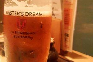 Enjoying a beer from the Nomihodai formula