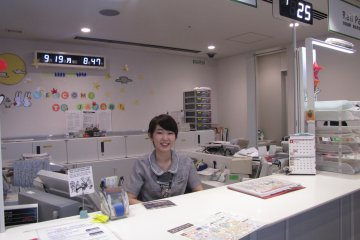 The friendly staff at the JR East Tokyo Station travel centre