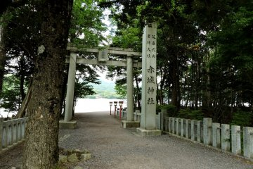 Stone torii and lanterns mark the approach to the bridge