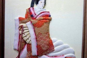Кукла осиэ в раме